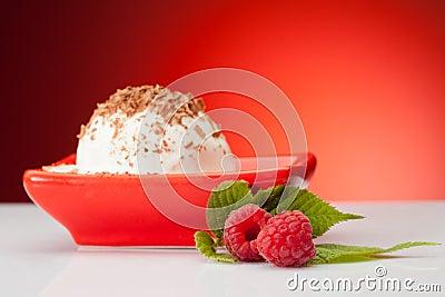 Raspberries with vanilla ice cream