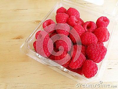 Raspberries on wood table