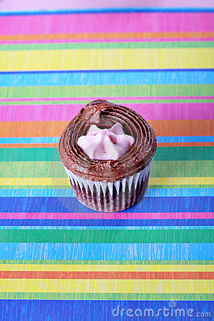 Raspberry filled cupcake on colorful background