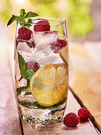 Free Raspberry Mojito With Cubes Ice Glass. Outdoor. Stock Photos - 75243643