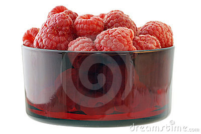 Rasperries in glass red bowl
