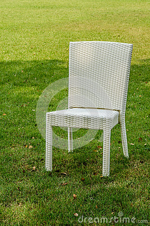 Free Rattan Chair In The Garden Royalty Free Stock Images - 68463359