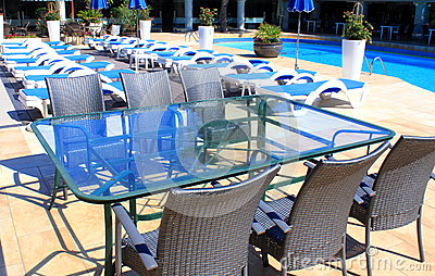 Rattan furniture at patio near pool
