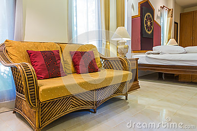 Rattan sofa in bedroom