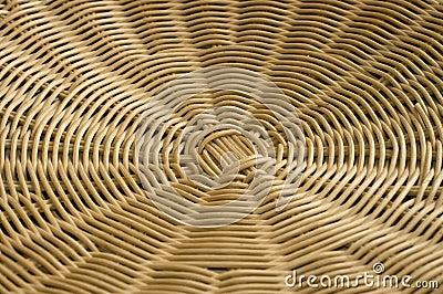 Rattan weave in radial pattern.
