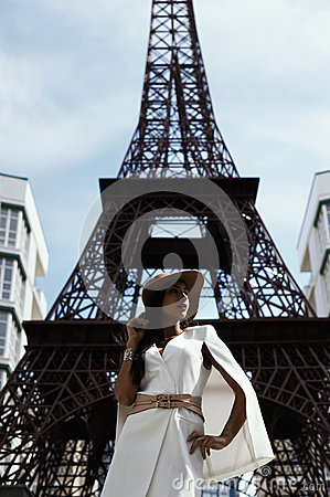 Free Raven Haired Indian Lady Posing Against Fake Eiffel Tower Royalty Free Stock Photos - 72177038