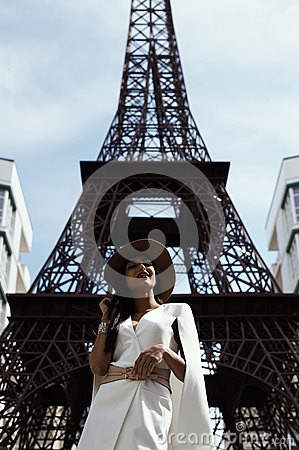 Free Raven Haired Indian Lady Posing Against Fake Eiffel Tower Royalty Free Stock Image - 72528266