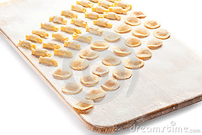 Ravioli on wooden board