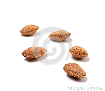 Raw almonds on white background