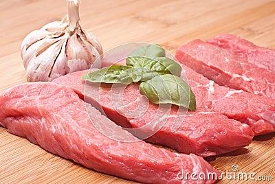 Raw beef on cutting board