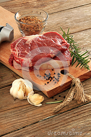 Raw prime rib beef steaks with spices, garlic and rosemary. Also ...