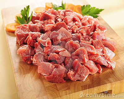 Raw beef stew. Arrangement on a cutting board. Stock Photo