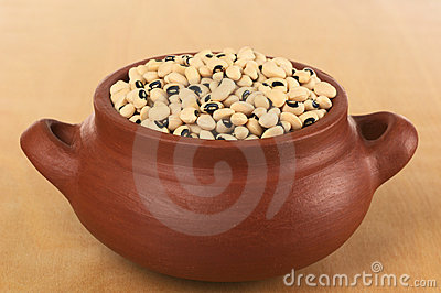 Raw Black-Eyed Peas in Rustic Bowl