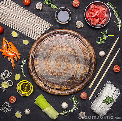 Free Raw Buckwheat Noodles With Vegetables, Ginger, Chopsticks And Ingredients, Laid Out Around Cutting Board Place For Text,frame Royalty Free Stock Photo - 67865185