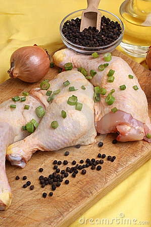 Raw   chicken drumstick with spring onion