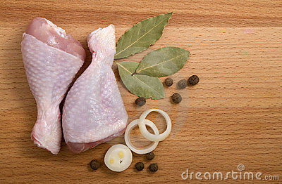 Raw chicken meat with herbs, onions and peppers