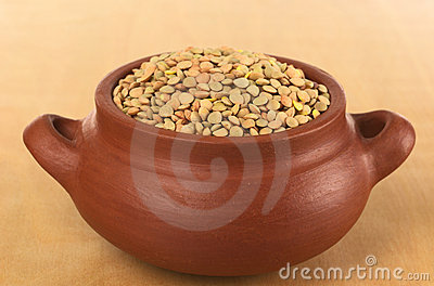 Raw Dried Lentils in Rustic Bowl