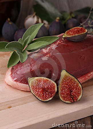 Raw duck breast and figs