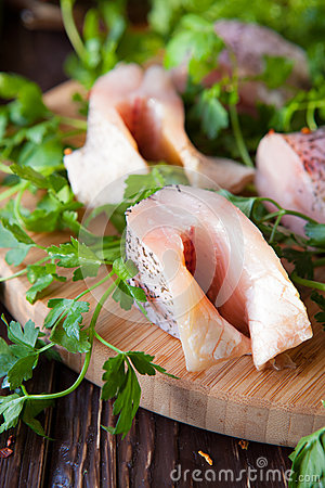 Free Raw Fillet Of Pike Fish On Board And Greens Stock Photo - 30652500