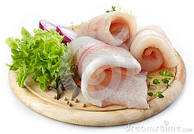 Raw fish fillets on wooden cutting board Stock Photo