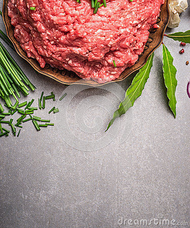 Free Raw Force Meat And Fresh Green Seasoning Ingredients For Tasty Cooking On Stone Background Royalty Free Stock Images - 68872849