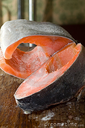 Raw freezed sliced salmon prepared for cooking.