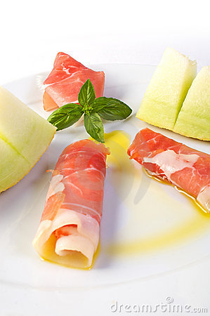 Raw ham and yellow melon