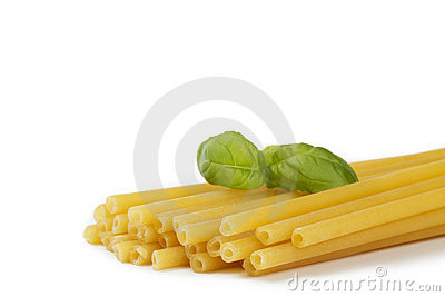 Raw macaroni with basil