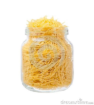 Raw macaroni in jar