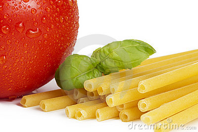 Raw macaroni with tomato and basil