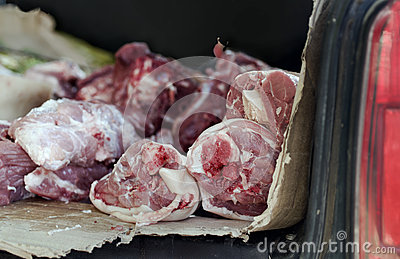 Raw Meat In Car Trunk Stock Photo