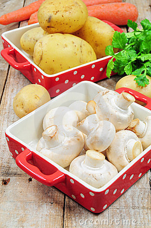 Raw mushrooms and potatoes