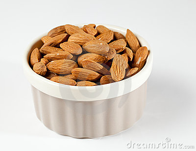 Raw organic almonds in bowl