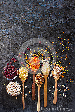 Free Raw Organic Cereal Grains, Seeds And Beans In Wooden Spoons And Bowls Royalty Free Stock Photography - 94023597