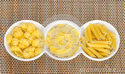 Raw pasta in bowl