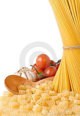 Raw pasta and wooden spoon isolated