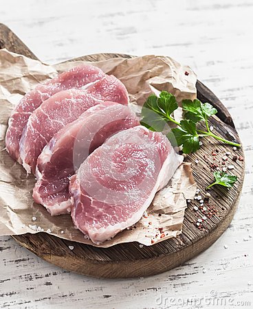 Free Raw Pork Chops On A Wooden Cutting Board Royalty Free Stock Photography - 68934267