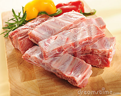 Raw pork ribs. Arrangement on a cutting board.