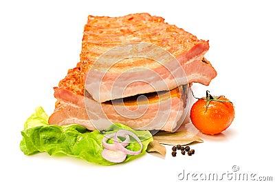 Raw pork ribs cut in half