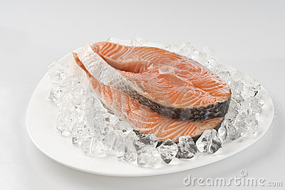 Raw salmon steak over ice