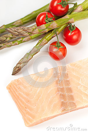 Raw salmon steak and vegetables