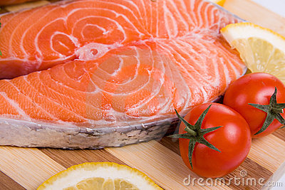 Raw salmon on a wooden board