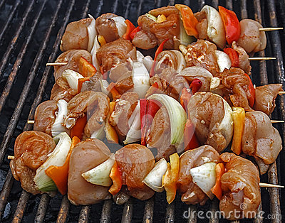 Raw skewers, graded and placed on the grill-1