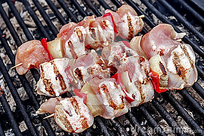 Raw skewers, graded and placed on the grill