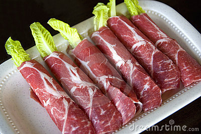 Raw Sliced Lamb Rolls