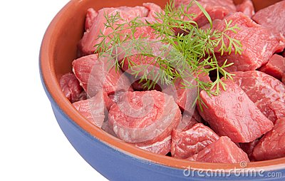 Raw sliced meat with dill  in a bowl