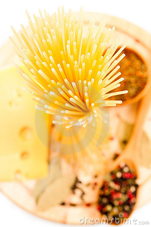 Raw spaghetti with cheese and spices