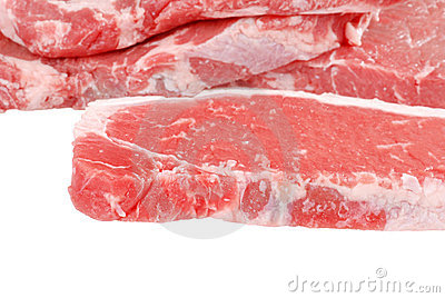 Raw strip loin steaks