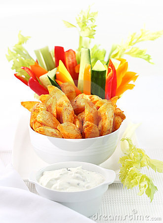 Raw vegetable and wedges with dip