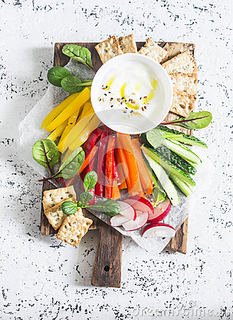 Free Raw Vegetables And Yogurt Sauce On A Wooden Cutting Board, On A Light Background, Top View. Vegetarian Healthy Food Stock Image - 99114941
